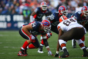 ORCHARD PARK, NY - OCTOBER 11:  Aaron Schobel #94 of the Buffalo Bills lines up on the outside against Robert Royal #84 of the Cleveland Browns during their NFL game at Ralph Wilson Stadium on October 11, 2009 in Orchard Park, New York. The Browns defeate