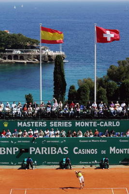 MONTE CARLO, MONACO - APRIL 23:  Rafael Nadal of Spain serves against Roger Federer of Switzerland in the final of the Rolex ATP Tennis Masters Monte Carlo at the The Monte Carlo Country Club on April 23, 2006 in Monte-Carlo, Monaco.  (Photo by Michael St