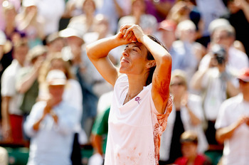PARIS - JUNE 05:  Francesca Schiavone of Italy celebrates winning championship point during women's singles final match between Francesca Schiavone of Italy and Samantha Stosur of Australia on day fourteen of the French Open at Roland Garros on June 5, 20