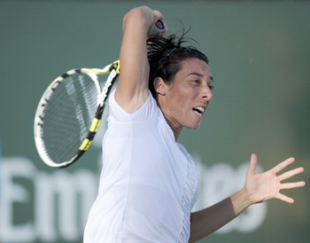 INDIAN WELLS, CA - MARCH 11:  Francesca Schiavone of Italy hits a forehand in her match against Zuzana Ondraskova of The Czech Republic during the BNP Paribas Open at the Indian Wells Tennis Garden on March 11, 2011 in Indian Wells, California.  (Photo by