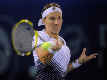 DUBAI, UNITED ARAB EMIRATES - FEBRUARY 18:  Svetlana Kuznetsova of Russia plays a shot during her quarter-final match against Agnieszka Radwanska of Poland during day five of the Dubai Duty Free Tennis Championships at the Dubai Tennis Stadium on February