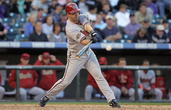 DENVER, CO - APRIL 01:  Willie Bloomquist #18 of the Arizona Diamondbacks takes an at bat against the Colorado Rockies during Opening Day at Coors Field on April 1, 2011 in Denver, Colorado. The Diamondbacks defeated the Rockies 7-6 in 11 innings.  (Photo