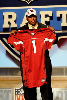 NEW YORK - APRIL 22:  Dan Williams from the Tennessee Volunteers holds up a Arizona Cardinals jersey after he was selected number 26 overall by the Cardinals during the first round of the 2010 NFL Draft at Radio City Music Hall on April 22, 2010 in New Yo