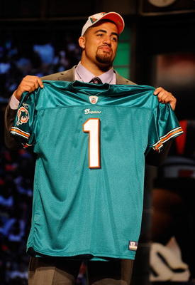 NEW YORK - APRIL 22:  Jared Odrick from Penn State holds up a Miami Dolphins jersey after the Dolphins selected Odrick number 28 overall during the first round of the 2010 NFL Draft at Radio City Music Hall on April 22, 2010 in New York City.  (Photo by J