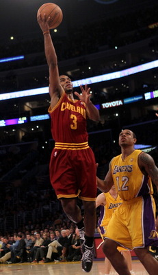 LOS ANGELES, CA - JANUARY 11:  Ramon Sessions #3 of the Cleveland Cavaliers shoots over Shannon Brown #12 of the Los Angeles Lakers at Staples Center on January 11, 2011 in Los Angeles, California.  The Lakers won 112-57.  NOTE TO USER: User expressly ack