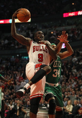 CHICAGO, IL - APRIL 07: Loul Deng #9 of the Chicago Bulls drives to the basket past Paul Pierce #34 of the Boston Celtics at United Center on April 7, 2011 in Chicago, Illinois. The Bulls defeated the Celtics 97-81. NOTE TO USER: User expressly acknowledg