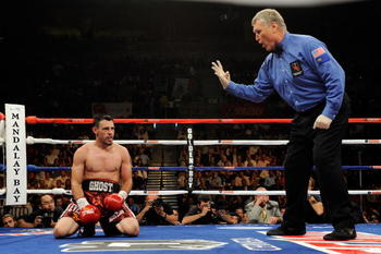 LAS VEGAS - JULY 31:  Referee Jay Nady counts as Robert Guerrero kneels on the canvas after being hit by Joel Casamayor in the 10th round of their junior welterweight fight at the Mandalay Bay Events Center July 31, 2010 in Las Vegas, Nevada. Guerrero won