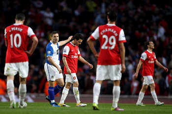 LONDON, ENGLAND - APRIL 02:  David Dunn of Blackburn consoles Cesc Fabregas of Arsenal during the Barclays Premier League match between Arsenal and Blackburn Rovers at the Emirates Stadium on April 2, 2011 in London, England.  (Photo by Julian Finney/Gett