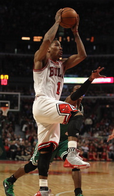 CHICAGO, IL - APRIL 07: Derrick Rose #1 of the Chicago Bulls goes up for a shot past Rajon Rondo #9 of the Boston Celtics at United Center on April 7, 2011 in Chicago, Illinois. The Bulls defeated the Celtics 97-81. NOTE TO USER: User expressly acknowledg