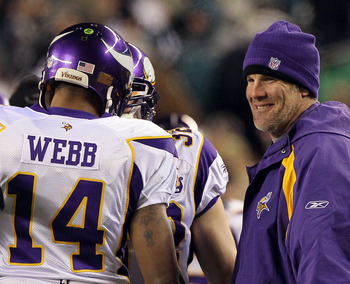 PHILADELPHIA, PA - DECEMBER 28:  Injured Quarterback Brett Favre (R) #4 congratulates Joe Webb #14 of the Minnesota Vikings after scoring a touchdown against the Philadelphia Eagles at Lincoln Financial Field on December 26, 2010 in Philadelphia, Pennsylv