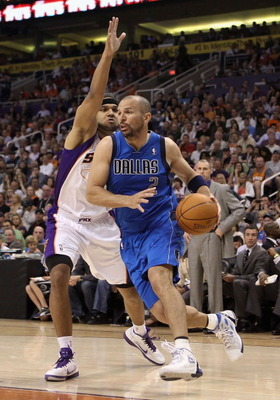 PHOENIX, AZ - MARCH 27:  Jason Kidd #2 of the Dallas Mavericks drives the ball past Jared Dudley #3 of the Phoenix Suns during the NBA game at US Airways Center on March 27, 2011 in Phoenix, Arizona.  NOTE TO USER: User expressly acknowledges and agrees t