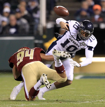 SAN FRANCISCO, CA - JANUARY 09:  Colin Kaepernick #10 of the Nevada Wolf Pack fumbles the ball after being hit by Mark Herzlich #94 of the Boston College during the Kraft Fight Hunger Bowl at AT&T Park on January 9, 2011 in San Francisco, California.  (Ph