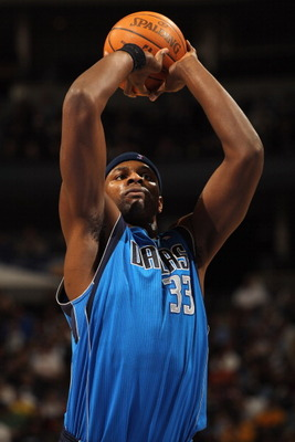 DENVER, CO - FEBRUARY 10:  Brendan Haywood #33 of the Dallas Mavericks takes a free throw against the Denver Nuggets during NBA action at the Pepsi Center on February 10, 2011 in Denver, Colorado. The Nuggets defeated the Mavericks 121-120. NOTE TO USER: