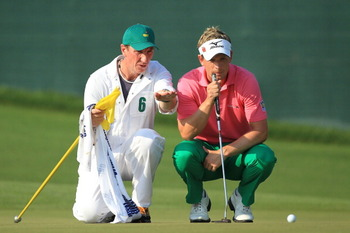 AUGUSTA, GA - APRIL 09:  Luke Donald of England (R) and caddie John McLaren line up a putt on the 17th green during the third round of the 2011 Masters Tournament at Augusta National Golf Club on April 9, 2011 in Augusta, Georgia.  (Photo by David Cannon/