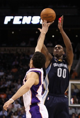 PHOENIX - DECEMBER 08:  Darrell Arthur #00 of the Memphis Grizzlies puts up a shot against the Phoenix Suns during the NBA game at US Airways Center on December 8, 2010 in Phoenix, Arizona. NOTE TO USER: User expressly acknowledges and agrees that, by dow