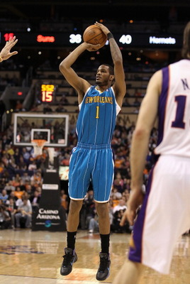 PHOENIX, AZ - JANUARY 30:  Trevor Ariza #1 of the New Orleans Hornets puts up a shot during the NBA game against  the Phoenix Suns at US Airways Center on January 30, 2011 in Phoenix, Arizona.  The Suns defeated the Hornets 104-102. NOTE TO USER: User exp