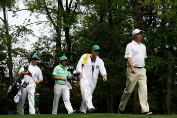 AUGUSTA, GA - APRIL 09:  Fred Couples (R) and Rickie Fowler walk off the second tee with their caddies during the third round of the 2011 Masters Tournament at Augusta National Golf Club on April 9, 2011 in Augusta, Georgia.  (Photo by David Cannon/Getty