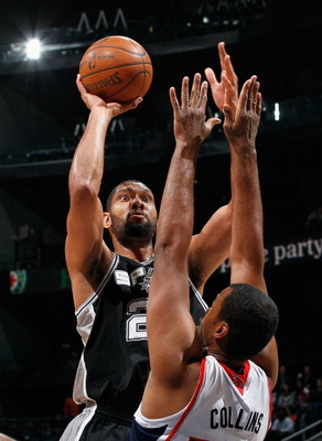 ATLANTA, GA - APRIL 05:  Tim Duncan #21 of the San Antonio Spurs shoots against Jason Collins #34 of the Atlanta Hawks at Philips Arena on April 5, 2011 in Atlanta, Georgia.  NOTE TO USER: User expressly acknowledges and agrees that, by downloading and/or