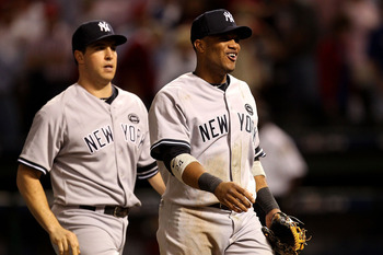 ARLINGTON, TX - OCTOBER 15:  Robinson Cano #24 (R) and Mark Teixeira #25 of the New York Yankees react after their 6-5 win against the Texas Rangers in Game One of the ALCS during the 2010 MLB Playoffs at Rangers Ballpark in Arlington on October 15, 2010