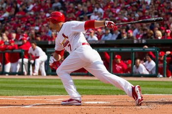 ST. LOUIS, MO - MARCH 31: Matt Holliday #7 of the St. Louis Cardinals hits an RBI single against the San Diego Padres on opening day at Busch Stadium on March 31, 2011 in St. Louis, Missouri.  (Photo by Dilip Vishwanat/Getty Images)