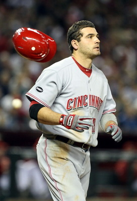 PHOENIX, AZ - APRIL 08:  Joey Votto #19 of the Cincinnati Reds flips his helmet after striking out against the Arizona Diamondbacks during the sixth inning of the Major League Baseball home opening game at Chase Field on April 8, 2011 in Phoenix, Arizona.