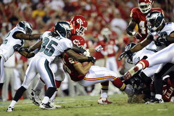 KANSAS CITY, MO - AUGUST 27: Jackie Battle #26 of the Kansas City Chiefs is stopped by Trevard Lindley #35 of the Philadelphia Eagles during a preseason game at Arrowhead Stadium on August 27, 2010 in Kansas City, Missouri.  (Photo by G. Newman Lowrance/G