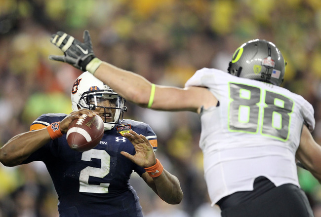GLENDALE, AZ - JANUARY 10:  Cameron Newton #2 of the Auburn Tigers scrambles against Brandon Bair #88 of the Oregon Ducks during the Tostitos BCS National Championship Game at University of Phoenix Stadium on January 10, 2011 in Glendale, Arizona.  (Photo