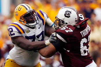 BATON ROUGE, LA - SEPTEMBER 22:  Glenn Dorsey #72  of the Louisiana State University Tigers blocks James Thompson #67 of the South Carolina Gamecocks at Tiger Stadium September 22, 2007 in Baton Rouge, Louisiana. (Photo by Chris Graythen/Getty Images)