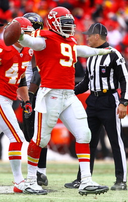 KANSAS CITY, MO - JANUARY 09:  Linebacker Tamba Hali #91 of the Kansas City Chiefs celebrates after recovering a fumble by the Baltimore Ravens during the first half of their 2011 AFC wild card playoff game at Arrowhead Stadium on January 9, 2011 in Kansa