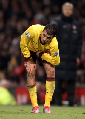 MANCHESTER, UNITED KINGDOM - DECEMBER 13:   Marouane Chamakh of Arsenal holds his leg after sustaining an injury during the Barclays Premier League match between Manchester United and Arsenal at Old Trafford on December 13, 2010 in Manchester, England. (P