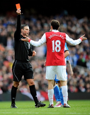 LONDON, ENGLAND - JANUARY 30:  Sebastien Squillaci #30 of Arsenal is shown a straight red card by Referee Mark Clattenburg after his foul on Jack Hunt of Huddersfield during the FA Cup sponsored by E.ON fourth round match between Arsenal and Huddersfield