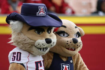 LOS ANGELES, CA - DECEMBER 5:  Arizona Wildcats mascots Wilbur the Wildcat and Wilma The Wildcat pose during the game between the Arizona Wildcats and the USC Trojans on December 5, 2009 at the Los Angeles Coliseum in Los Angeles, California.  Arizona won