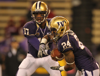 SEATTLE - OCTOBER 30:  Quarterback Keith Price #17 of the Washington Huskies hands off to Jesse Callier #24 against the Stanford Cardinal on October 30, 2010 at Husky Stadium in Seattle, Washington. Stanford won 41-0. (Photo by Otto Greule Jr/Getty Images