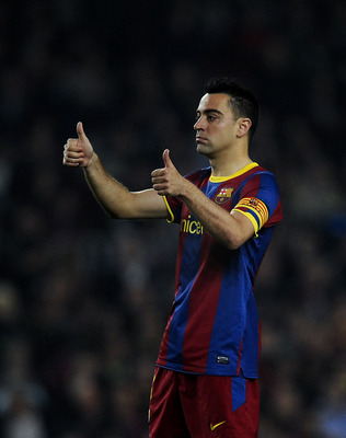 BARCELONA, SPAIN - APRIL 06:  Xavi Hernandez of FC Barcelona gives a thumbs up during the UEFA Champions League quarter final first leg match between Barcelona and Shakhtar Donetsk at the Camp Nou Stadium on April 6, 2011 in Barcelona, Spain.  (Photo by D