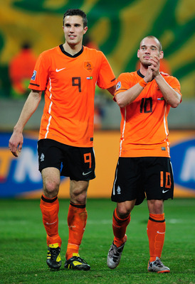 PORT ELIZABETH, SOUTH AFRICA - JULY 02:  Robin Van Persie and Wesley Sneijder of the Netherlands celebrate victory following the 2010 FIFA World Cup South Africa Quarter Final match between Netherlands and Brazil at Nelson Mandela Bay Stadium on July 2, 2