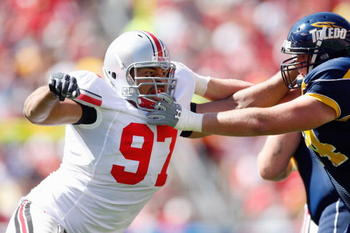 CLEVELAND - SEPTEMBER 19:  Cameron Heyward #97 of the Ohio State Buckeyes moves off the line during the game against the Toledo Rockets at Cleveland Browns Stadium on September 19, 2009 in Cleveland, Ohio. The Ohio State Buckeyes shutout the Toledo Rocket