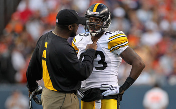 DENVER - AUGUST 29:  Head coach Mike Tomlin of the Pittsburgh Steelers has something to say to cornerback Keenan Lewis #23 after he was called for a personal foul as he tackled Brandon Lloyd of the Denver Broncos during preseason NFL action at INVESCO Fie