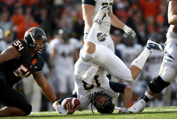 CORVALLIS, OR - NOVEMBER 15:  Quarterback Kevin Riley #13 of the California Golden Bears rolls on his head after being sacked by Stephen Paea #54 the Oregon State Beavers at Reser Stadium on November 15, 2008 in Corvalis, Oregon.  (Photo by Jonathan Ferre