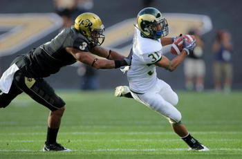 BOULDER, CO - SEPTEMBER 06:  Wide receiver Dion Morton #31 of the Colorado State Ramsmakes a reception as cornerback Jimmy Smith #3 of the Colorado Buffaloes defends at Folsom Field on September 6, 2009 in Boulder, Colorado. The Rams defeated the Buffaloe