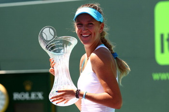 KEY BISCAYNE, FL - APRIL 02:  Victoria Azarenka of Belarus celebrates with the trophy after she her match against Maria Sharapova of Russia during the women's singles championship at the Sony Ericsson Open at Crandon Park Tennis Center on April 2, 2011 in