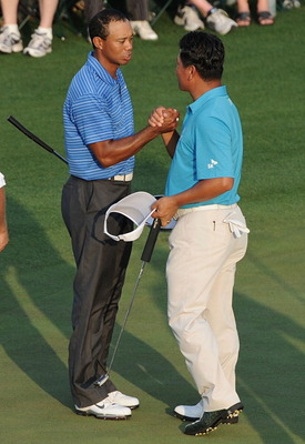 AUGUSTA, GA - APRIL 09:  Tiger Woods (L) shakes hands with K.J. Choi of South Korea on the 18th green during the third round of the 2011 Masters Tournament at Augusta National Golf Club on April 9, 2011 in Augusta, Georgia.  (Photo by Harry How/Getty Imag