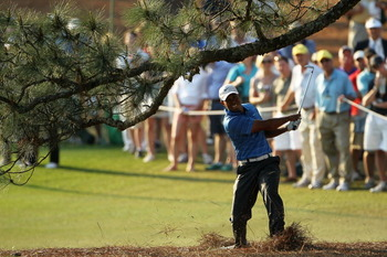 AUGUSTA, GA - APRIL 09:  Tiger Woods hits a shot from the pine needles on the 17th hole during the third round of the 2011 Masters Tournament at Augusta National Golf Club on April 9, 2011 in Augusta, Georgia.  (Photo by Jamie Squire/Getty Images)