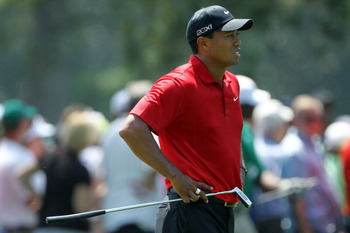 AUGUSTA, GA - APRIL 10:  Tiger Woods waits in the first fairway during the final round of the 2011 Masters Tournament at Augusta National Golf Club on April 10, 2011 in Augusta, Georgia.  (Photo by Jamie Squire/Getty Images)