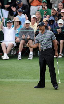 AUGUSTA, GA - APRIL 08:  Tiger Woods celebrates making birdie on the ninth hole during the first round of the 2010 Masters Tournament at Augusta National Golf Club on April 8, 2010 in Augusta, Georgia.  (Photo by Harry How/Getty Images)