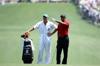 AUGUSTA, GA - APRIL 10:  Tiger Woods waits in the first fairway with his caddie Steve Williams during the final round of the 2011 Masters Tournament at Augusta National Golf Club on April 10, 2011 in Augusta, Georgia.  (Photo by Andrew Redington/Getty Ima