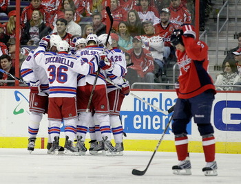 WASHINGTON, DC - FEBRUARY 25:  Members of the New York Rangers celebrate scoring a goal against the Washington Capitals at the Verizon Center on February 25, 2011 in Washington, DC.  (Photo by Rob Carr/Getty Images)