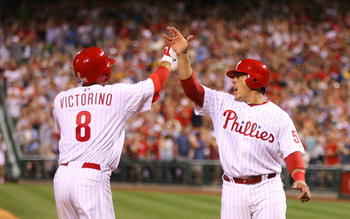PHILADELPHIA - MAY 2: Center fielder Shane Victorino #8 of the Philadelphia Phillies is greeted by catcher Carlos Ruiz #51 after hitting a grand slam during a game against the New York Mets at Citizens Bank Park on May 2, 2010 in Philadelphia, Pennsylvani