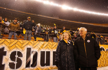PITTSBURGH - JANUARY 28:  Owner of the Pittsburgh Steelers Dan Rooney (R) and his wife walk to the stage during the Super Bowl XLV Pep Rally on January 28, 2011 at Heinz Field in Pittsburgh, Pennsylvania.  (Photo by Jared Wickerham/Getty Images)
