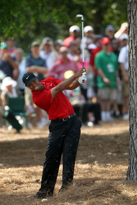 AUGUSTA, GA - APRIL 10:  Tiger Woods hits from the pine needles on the ninth hole during the final round of the 2011 Masters Tournament at Augusta National Golf Club on April 10, 2011 in Augusta, Georgia.  (Photo by Jamie Squire/Getty Images)