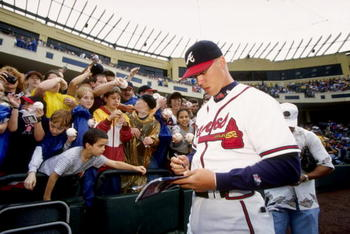 28 Feb 1998:  Chipper Jones #10 of the Atlanta Braves signs autographs for fans during a spring training game against the New York Mets at the Disney Wide World of Sports Stadium in Orlando, Florida. The Braves defeated the Mets 3-2. Mandatory Credit: And